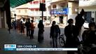 Moradores respeitando distanciamento e utilizando máscaras em fila de casa lotérica em Itarana